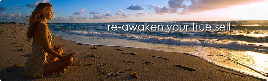 Re-awaken your true self, woman meditating on beach